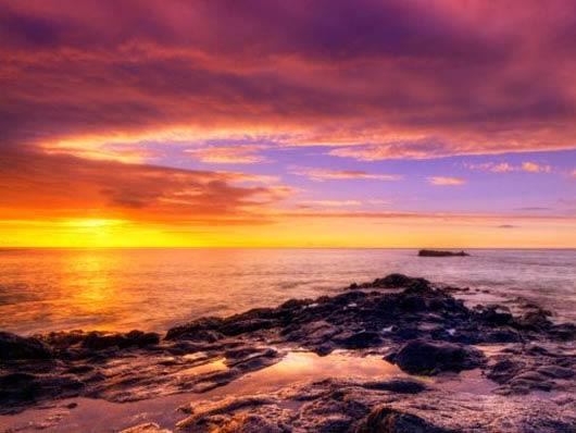 Foto Tramonto al Mare